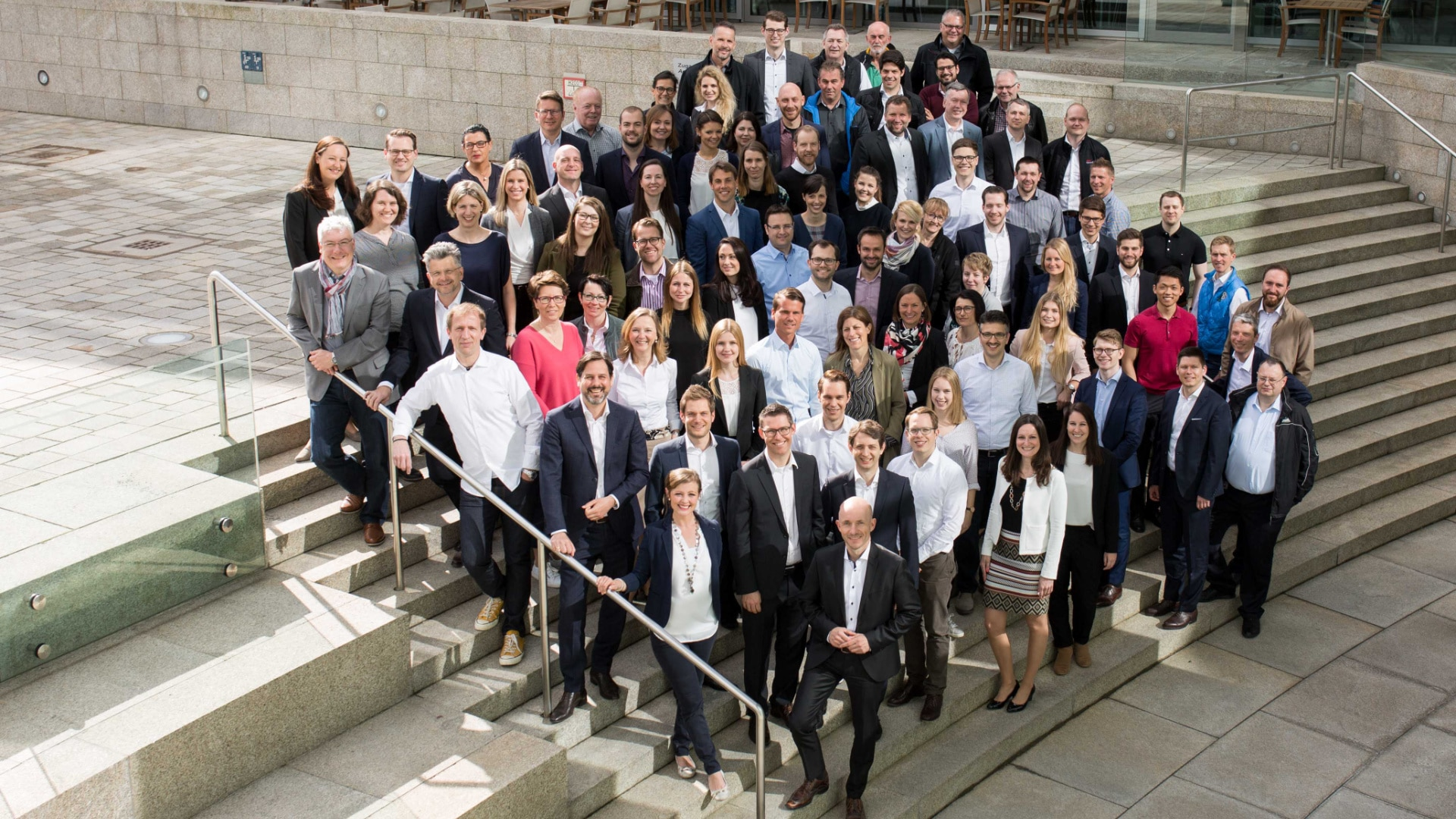 The 100 or so employees of Audi Consulting on the steps outside the museum Mobile Ingolstadt.